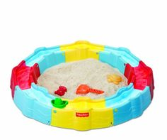 Engage bright minds with sandy hands. This versatile sandbox is designed to keep little ones occupied with a grooved water canal and playful accessories galore! From Fisher-Price. Sandbox, Fisher Price, Kids Learning, Play, Free Shipping, Toys, Building, Top Rated, Water