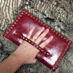"Last two!!! Red studded clutch with hand strap Beautiful faux leather studded clutch, with hand strap. Magnetic snap closure. Three main pockets, two small cell phone pockets, one internal zippered pocket, one external zippered pocket. Height: 6.25"", width: 11"", height when open: 13"". Wristlet and on the shoulder option. Several colors available. Brand new from vendor, NO TAGS. In original packaging. Please ask me to make you a separate listing, DO NOT PURCHASE THIS LISTING. Bags Clutches…"
