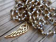 Hey, I found this really awesome Etsy listing at https://www.etsy.com/listing/202493809/guardian-angel-angel-wing-artisan-rosary