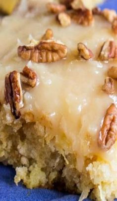 Pineapple Sheet Cake ~ flavored and moistened with crushed pineapple and topped with a sweet icing laced with shredded coconut, and sprinkled with pecans is a wonderful dessert to make to feed a crowd. by rhonda.white.52206