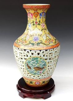 A Fine Carved Chinese Qing Dynasty Famille Rose Porcelain Vase with a Qianlong Mark, Decorated of a Painting of Fishes and Flowers, Size: H*D 40.5*22cm