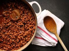New England-Style Baked Beans    You know that old saw about how, if you're trying to sell your house, you should always have a batch of cookies baking in the oven when you show the place?   Forget that. Ditch the cookies and simmer a pot of these New England-Style Baked Beans for six hours. The darkly sweet aroma coming from the oven is the most enticing, comforting thing you can imagine.