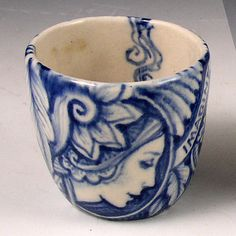 "I hand formed and cobalt painted this cup with three ladies and the word ""imagine"". It is high fired with a glossy clear glaze. The height is 2.3"" and the width is 2.4"" and holds about 3 oz."