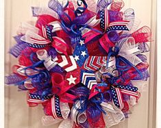 Celebrate Patriotic Holidays, Labor Day or a Solders Homecoming with this red, white and blue deco mesh wreath. It is made with Flag ribbons, silky ribbons and glittered springs. The center of the wreath is made with a three layered wooded star that shows in red, white and blue. All your friends and neighbors will be jealous with envy and want one hanging in there home too-- It measure a large 24 inches and can ship out within 3 to 5 days.  God Bless America