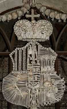 "Discover Sedlec Ossuary ""Bone Church"" in Kutna Hora, Czechia: A church of bones, decorated with human skeletons."
