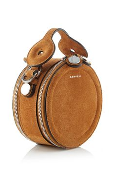 Click product to zoom This **Carven** pouch is rendered in suede leather and features a structured circle shape with a single top handle and dual tip compartments. Purses And Handbags, Leather Handbags, Brown Handbags, Cute Bags, Beautiful Bags, My Bags, Suede Leather, Brown Suede, Saddle Bags