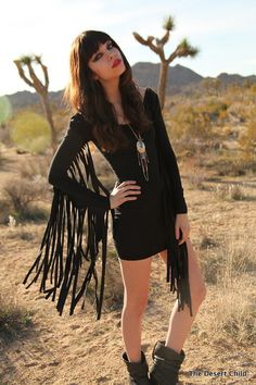 Give your collection a 70's inspired look by this fringed black dress!!