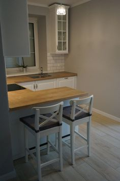 The kitchen in a Scandinavian style - image of furniture FILMAR
