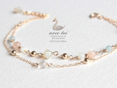 Delicate bead link double strand bracelet
