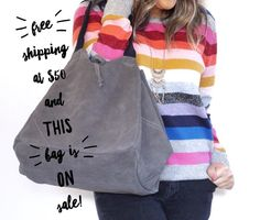 Join the suede craze with this slouchy carryall, complete with an inner pouchette for your keys, wallet, jewels – you name it! Make this multi-tasking hero your new style companion!   This Charcoal Suede Slouchy Tote is 30% off today and tomorrow. Normal price is $125, sale price is $87!⭐️ Snag this baby before someone else does!   http://www.chloeandisabel.com/boutique/beckycrotts
