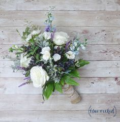 This silk wedding bouquet is full of white and cream silk flowers, peonies, blue berries, blue wildflowers and greenery. This boho bouquet is beautiful and unique. Absolutely perfect for a fall, rustic or boho wedding. This is the large, bridal bouquet. Shown wrapped in burlap