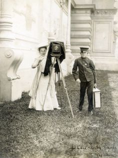Jessie Tarbox Beals and Punkin set up to take a photograph at the 1904 World's Fair. Jessie Tarbox Beals was one of the first women in the U.S. to have a career as a photojournalist. She is perhaps best remembered for her photos of the 1904 Olympics and World's Fair in St. Louis. As a female photographer, she initially had a difficult time getting a press pass to the Fair. She took many poignant photos of the people on display in the human exhibits, as well as the rest of the 1904 World's Fair.