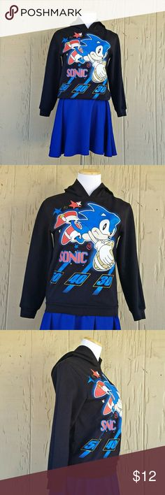 "Sega Sonic The Hedgehog Hoodie Sega Sonic The Hedgehog longsleeve football graphic hoodie featuring Sonic himself.  📐DIMENSIONS📐 Length: 22"" Chest: 17"" Shoulder: 15"" Sleeve: 19.5"" Hood: 13.25""  60% Cotton 40% Polyester  Size: 10/12 (boys)  Color(s): Black / blue, red, white, yellow Shirts & Tops Sweatshirts & Hoodies"