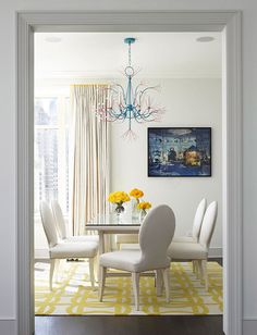 Monotone dining room can easily be updated and pops of color added thru accessories