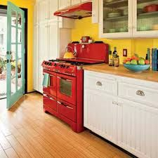 Yellow kitchen with red, turquoise, and black accents.