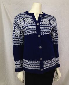 Vintage Norwegian Sweater North Cape by Knut and Knut Ltd. Norway Cardigan Wool 1960s Preppy vintage Norwegian sweater in a blue, light blue and white snowflake knit. Metal buttons down the front. Made by Knut and Knut Ltd. of Norway.