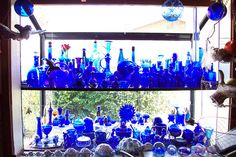 Day 012: Cobalt Blue Glass Bottles by Binder Of Daemons, via Flickr