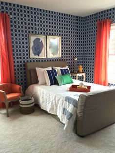 Pair up navy blue and orange for a dramatic bedroom color scheme. Crisp white bedding and accent pillows, gloss tray, organic woven basket, silk curtains, and framed coral art and accessories all from HomeGoods. Sponsored Happy By Design Post.