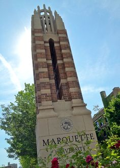 Marquette University campus marker at 16th Street and Wisconsin Avenue.