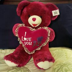 """Plush teddy bear with I love you heart Can we keep her, mom? This adorable teddy bear is so soft and cuddly that kids of ANY age will absolutely LOVE her! And she loves you back with the furry """"I love you heart"""" she holds in her hands. Her little red heart-shaped nose adds to her irresistibility. You will love snuggling up with this bear!  Approximately 22 inches  tall. SMOKE-FREE home. Other"""
