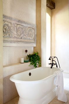 Tuscan design...freestanding bathtub.