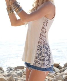 DIY - turning a tight tank top into a loose fitting shirt by adding lace to the sides.