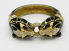 CINER Double Panther Black Enamel Hinged Clamper Bracelet Rare. Beauty is in the eye of the beholder, or the hand.  Incredible and Scarce this piece speaks volumns.