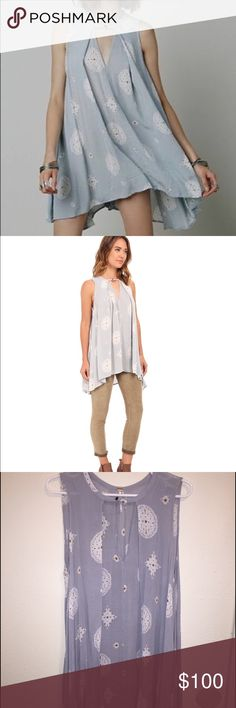 """RARE Free People Medallion Print Tree Swing Tunic Cut loose and swingy with a cool front cutout, this breezy medallion print tunic from Free People adds exotic edge to everything from love-worn cut-off shorts to dark denim skinnies.   🚨 SOLD OUT ON FREEPEOPLE.COM! RARE TUNIC AND VERY RARE COLOR/PRINT COMBO! 🚨 Barely worn, excellent condition.  29"""" front length; 32"""" back length (size Medium). Front keyhole with button closure Back box pleat, printed, loose fit, high/low hem V-neck…"""