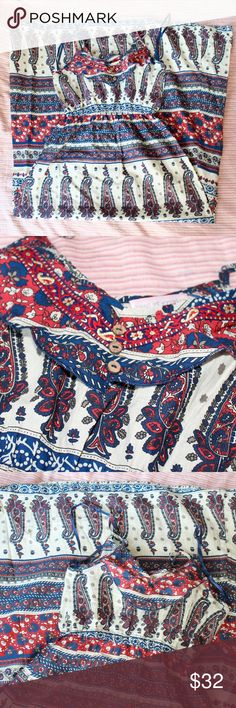 """Band of Gypsies Bohemian Paisley Print Maxi Dress An beautiful boho style dress that I purchased from Urban Outfitters that's the brand Band of Gypsies. Worn just once briefly, in like new condition without flaws. Features a stretchy waistband (approx 12"""" unstretched) and adjustable spaghetti straps. The print is an awesome all-over blue and red paisley print over a white background. Also has a ruffled trim on the neckline and button embellishment. Approx 15.5"""" from armpit to armpit laid…"""