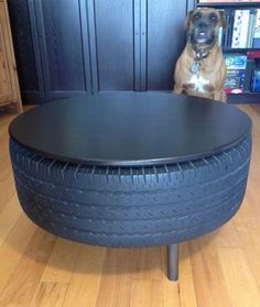 """tire table upcycle - looks like a """"man cave"""" idea Tire Table, Tire Chairs, Tire Seats, Automotive Shops, Automotive Decor, Tire Craft, Tire Furniture, Recycled Furniture, Modern Furniture"""
