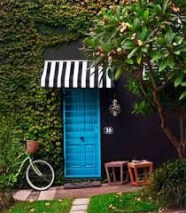striped canopy for blue door