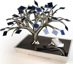 Beautiful bonsai tree inspired USB solar-cell charger.  The concept is created by Vivien Muller, a 22 year old designer from Paris, France.  The cords are hidden under the electronic tray and 54 tiny photovoltaic panels work together to store energy, so that you later can recharge your cell phone, MP3 player, PDA and any other handheld devices you might have.