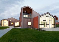 Fragmented gables form a cluster of archetypal house silhouettes at this children's centre.