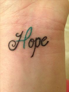 "My ""Hope"" wrist tattoo w green mental health awareness ribbon. Yay for being a psych nurse!"