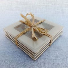 Set of 4 Wooden coasters each decorated with hand crafted recycled tea bag preserved under resin on cork base.