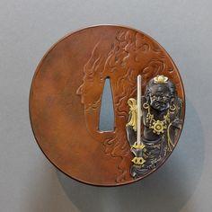 Tanabe Tomomasa - Mixed metal inlay Kinko tsuba with design of Fudo Myo-o. 19th Century. (Restoration work by Ford Hallam) http://www.militaria.co.za/nmb/uploads/monthly_12_2014/post-229-14196952933124.jpg