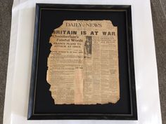 this is a recent job we did for a client a 1939 newspaper page framed with