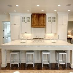 Beautiful Kitchen Features An Oversized Island Topped With White Marble Fitted With A Farm Sink Facing The Cooktop Lined With Wisteria Smart Sl