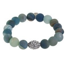 Our Blue Druzy Beaded Bracelets are accented by a Pave Crystal Bead. The beads are a matte finish on the outside, but are open to reveal a sugar like glimmering inside. Druzy has many metaphysical properties; most of which are directly related to the gem material with which it is attached. Overall, the stone purifies and amplifies the body's natural healing properties and strengthens the spirit.