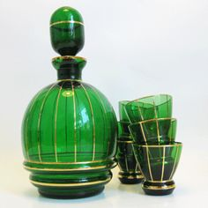 green and gold glass vintage barware in green #vintagefinds #stylebeat loves these, someone must reproduce these!