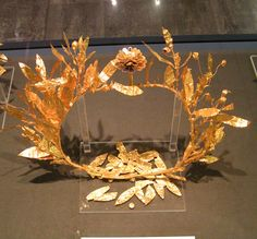 A gold diadem from the Pella museum  of the Great Tumulus at Vergina. Note the inlays on the petals of the flower.