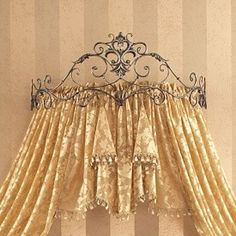 Love this idea for Alaina's room. With a pretty set of flowing canopy drapes