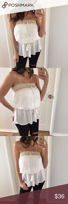 """White Crochet Loose Tube Top - I'm loving this top! So beautiful on. Perfect to pair with skinny jeans or shorts. Very versatile as well. Crochet band has a light stretch, middle of top as a light band that stretches. Top is loose in the chest area and in the bottom. Faux ties in front   - Modeling: Small  - Measures: Medium: 23"""" long • chest is open - Material: 100% Rayon   1 or 2 item bundles, please use the """"Buy It Now"""" feature. To start a bundle, please request your size Tops"""