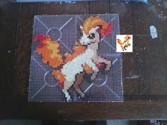 Ponyta in Hama/Nabbi beads 'Its hooves are 10 times harder than diamonds. Pokemon Ponyta in Hama Beads Kandi Patterns, Hama Beads Patterns, Beading Patterns, Fuse Beads, Pearler Beads, Pixel Art, Pokemon Cross Stitch, Pokemon Perler Beads, Melting Beads