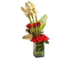 Glass vase arrangement of 12 Red roses with 6 tube roses.