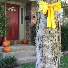 Welcome Home. yellow ribbon around tree