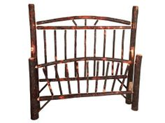www.foothillsamishfurniture.com -- Wagon Wheel Bed -- Enjoy the woodsy beauty of this hickory bed frame with its wagon wheel headboard. -- Do you want your bed to have the same style as your other cabin furniture? Comment below!