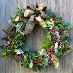 Velvet Brown door wreath, decorated on a woodland theme including lichen branches, fir cones, pheasant feathers and rich brown ribbon....