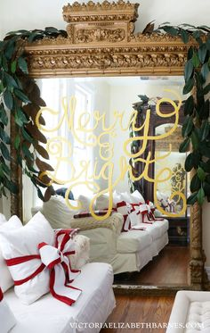 Write a holiday message that looks like gold leaf… glitter optional… I decorated the giant mirror (I scored on Craigslist!) but you can write on any glass surface.