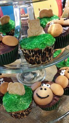Jungle theme Shower/party cupcakes - mix of pin-spirations - circus and monkey cupcakes. Used animal cookies from sprouts. TIP: put animal cookies right before party starts because they soften and flop over otherwise.